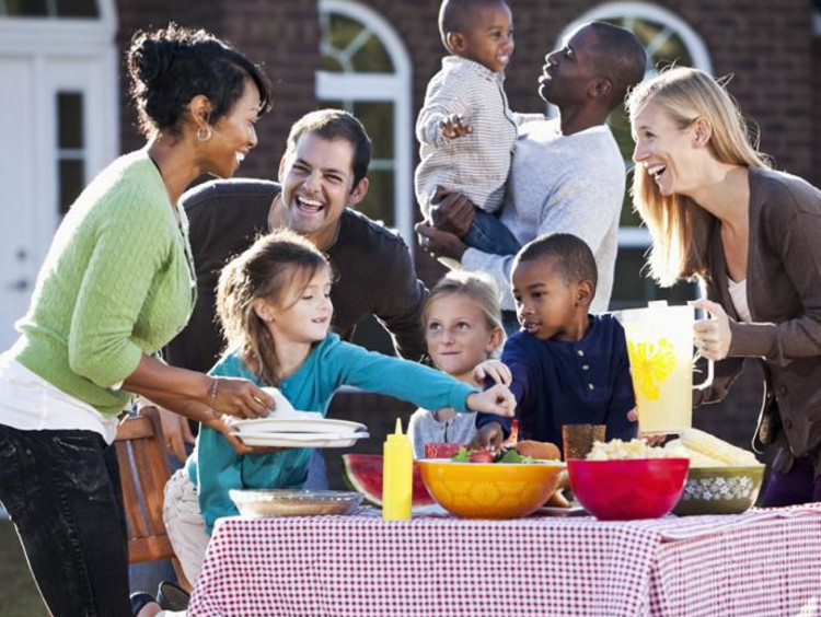 Two families gather for an outdoor cookout