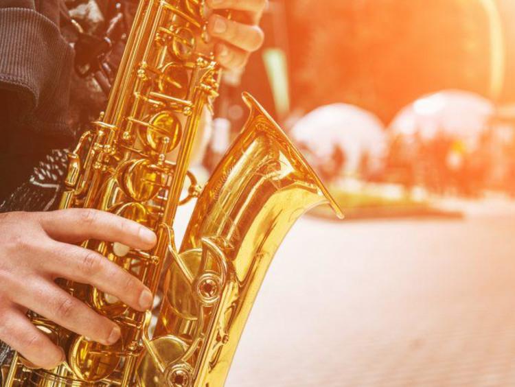 man plays the saxophone