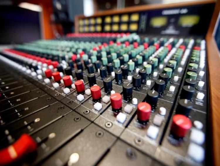 closeup of a recording studio sound board