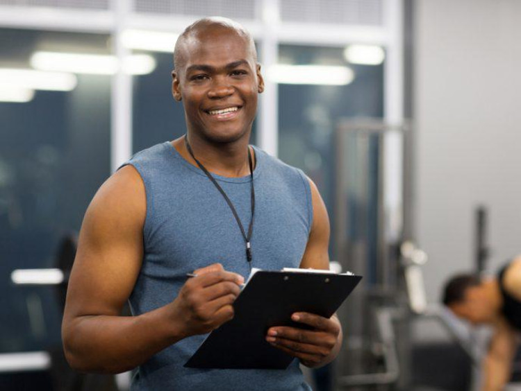 physical trainer holding clipboard