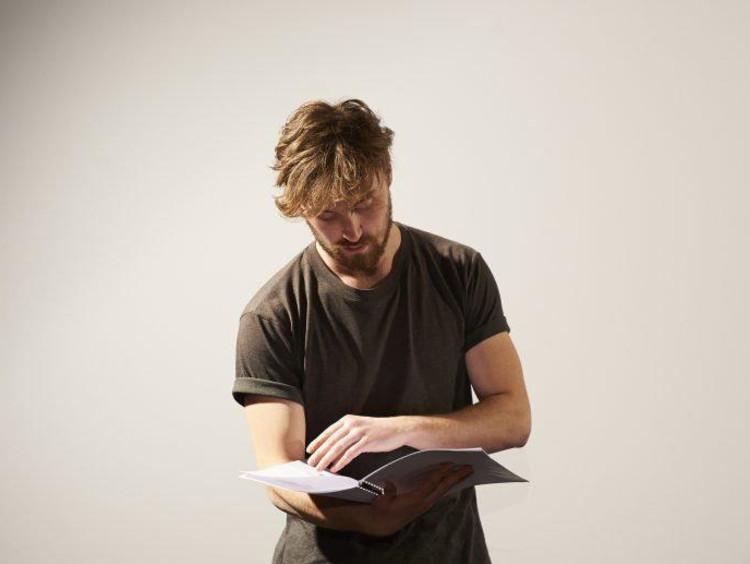 Guy reading script
