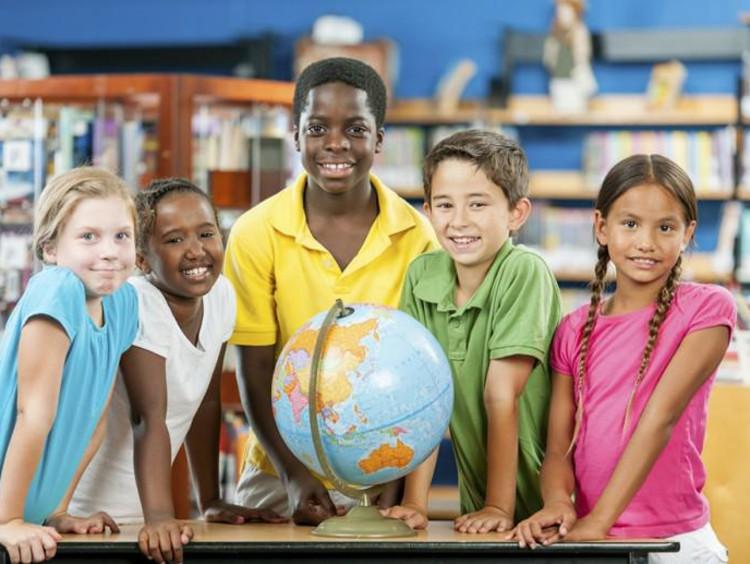 Children sharing in classroom setting