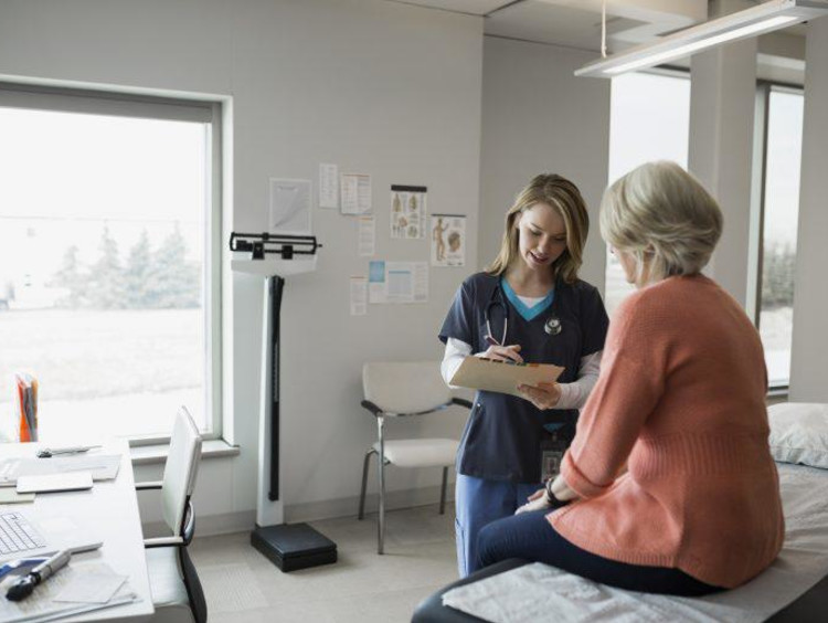 Nurse interacting with a patient