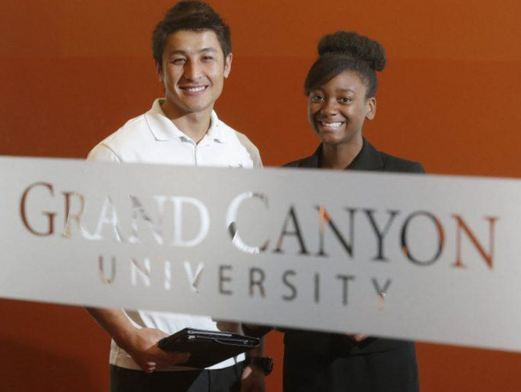 two GCU students smiling