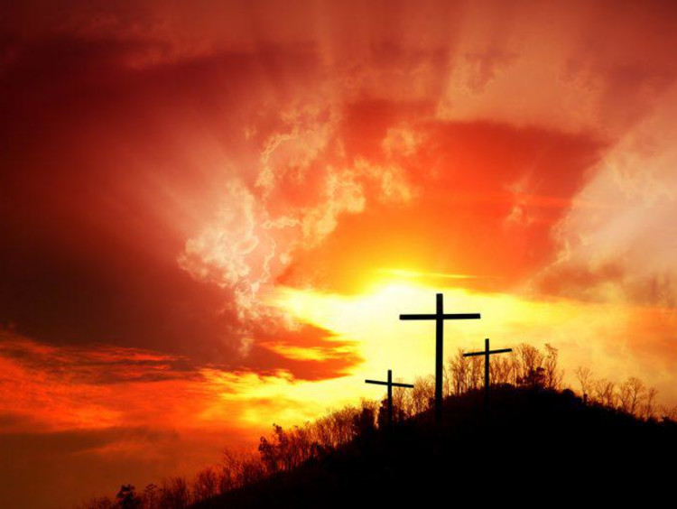 A hilltop with crosses at sunset