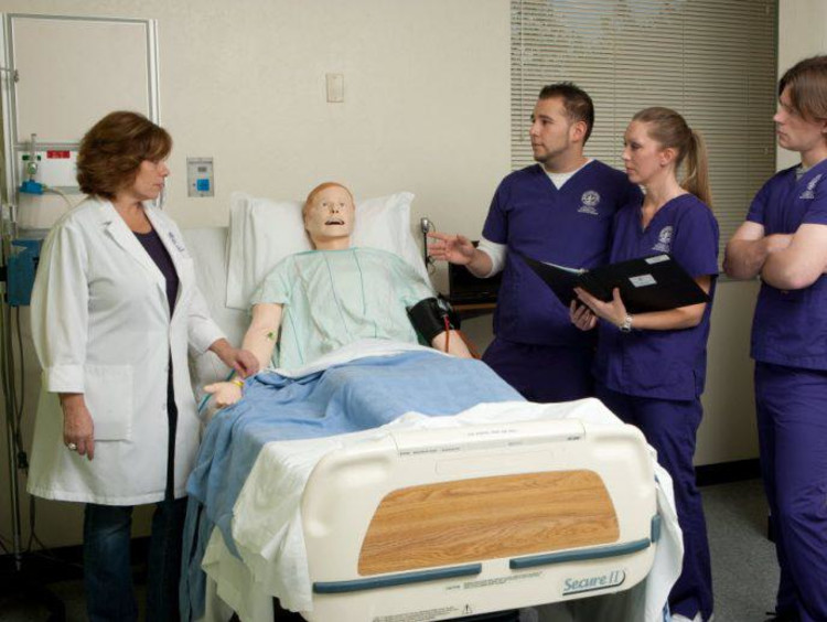 Nursing students learn patient techniques in a clinical setting