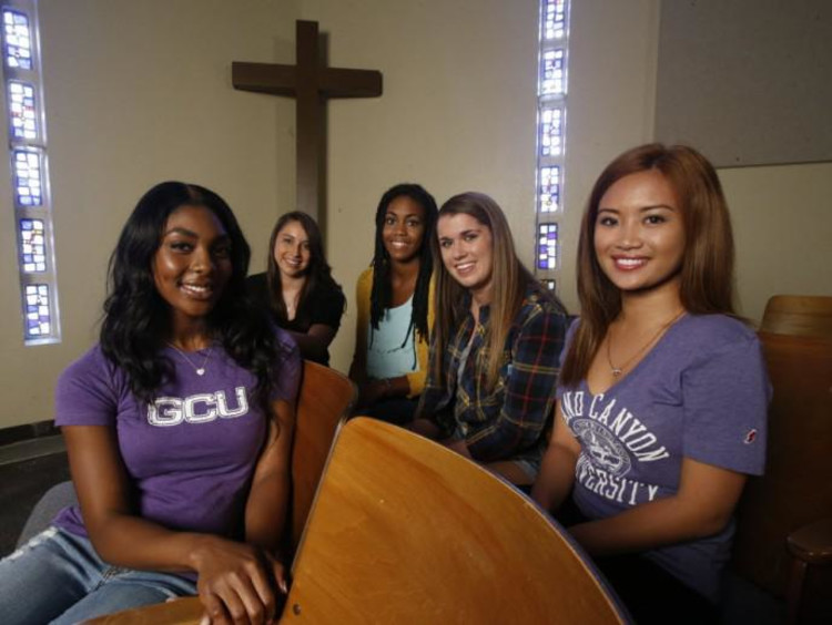 A group of students in GCU shirts in a church