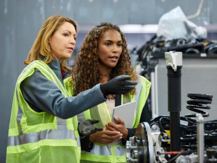 Two women doing mechanical engineering