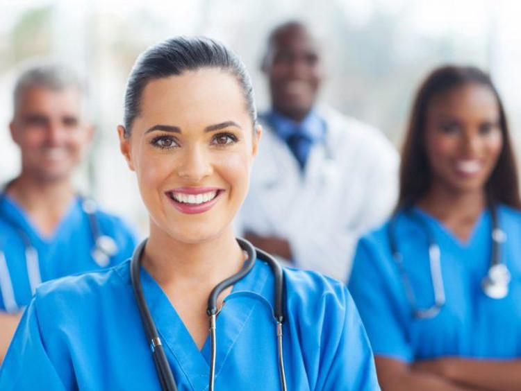 Nurses and doctor posing