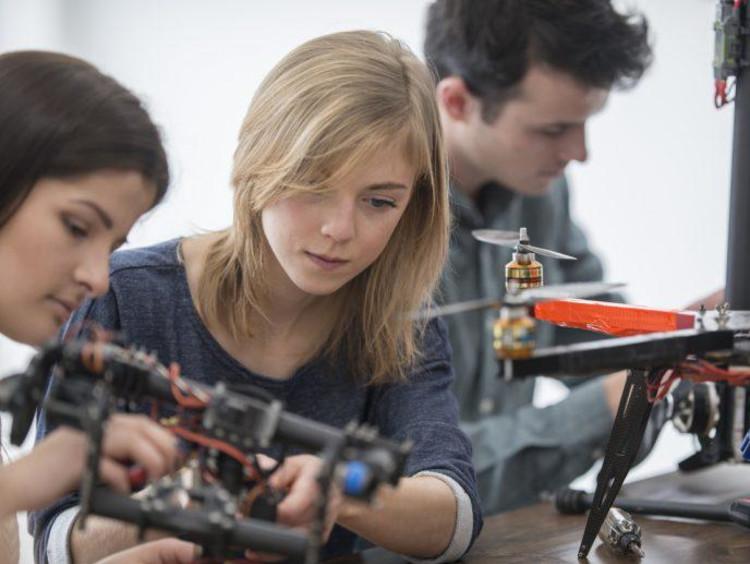 STEM students working in a robotics lab