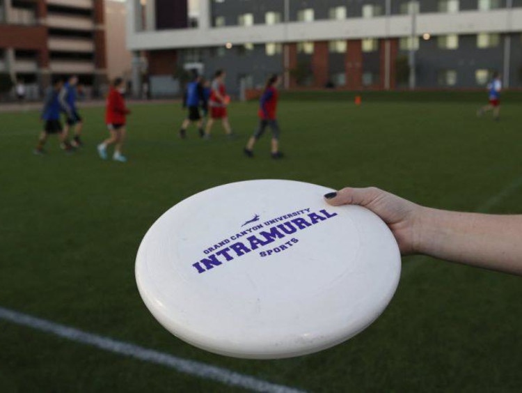 A GCU student playing Frisbee by the Grove dorms