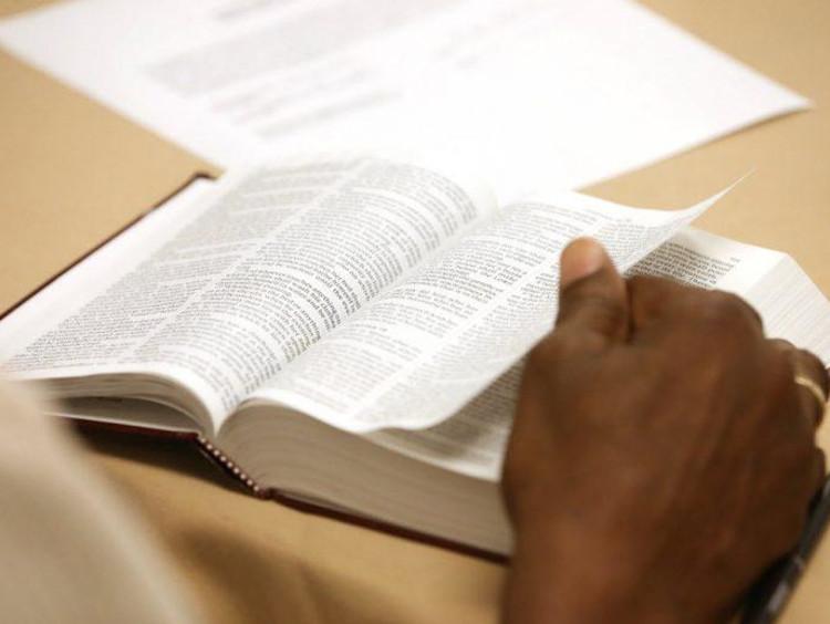 A man reading an open Bible