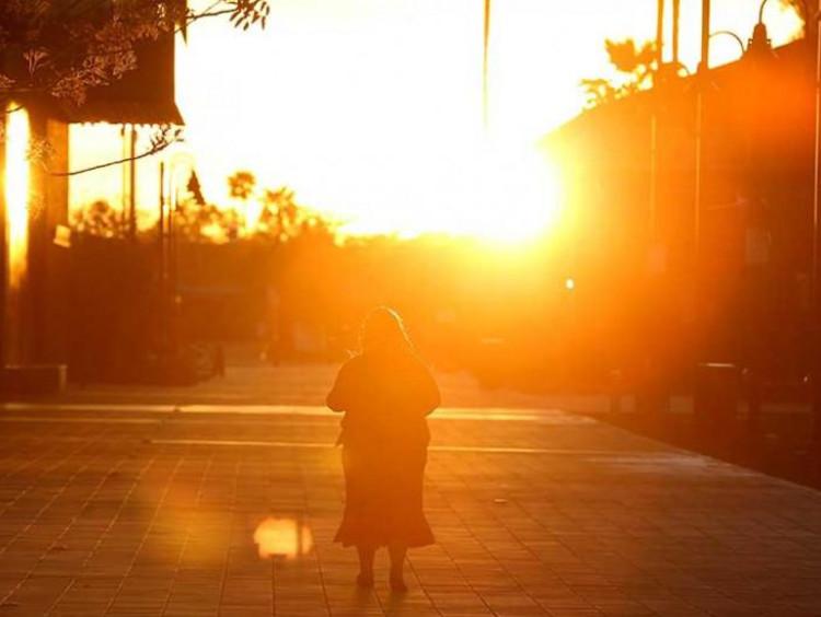 Someone biking into a sunset