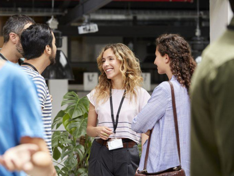 a group of MBA students networking outside of class