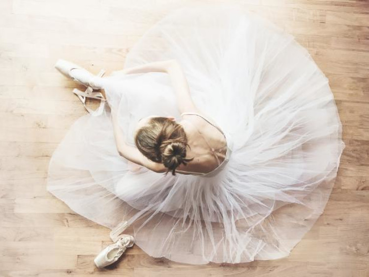 Ballerina putting on shoes