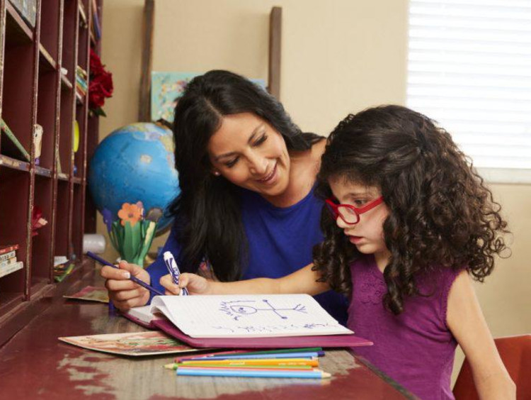 special education teacher working with young student
