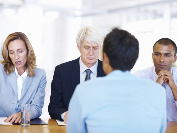 Man gets interviewed by executive leadership