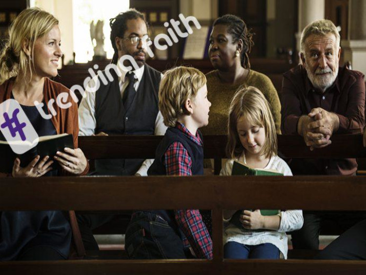 Family sits in church before service starts
