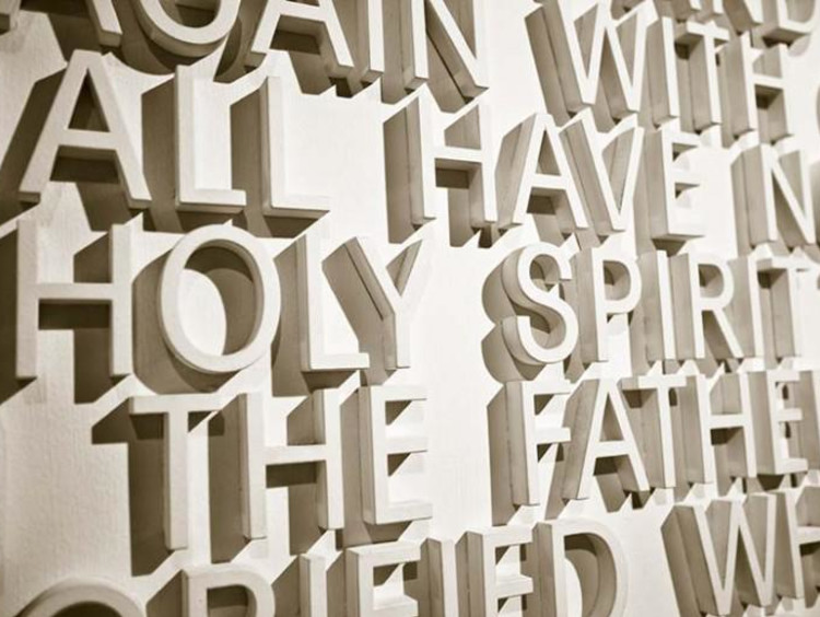 """holy spirit"" written with white letters on a wall"