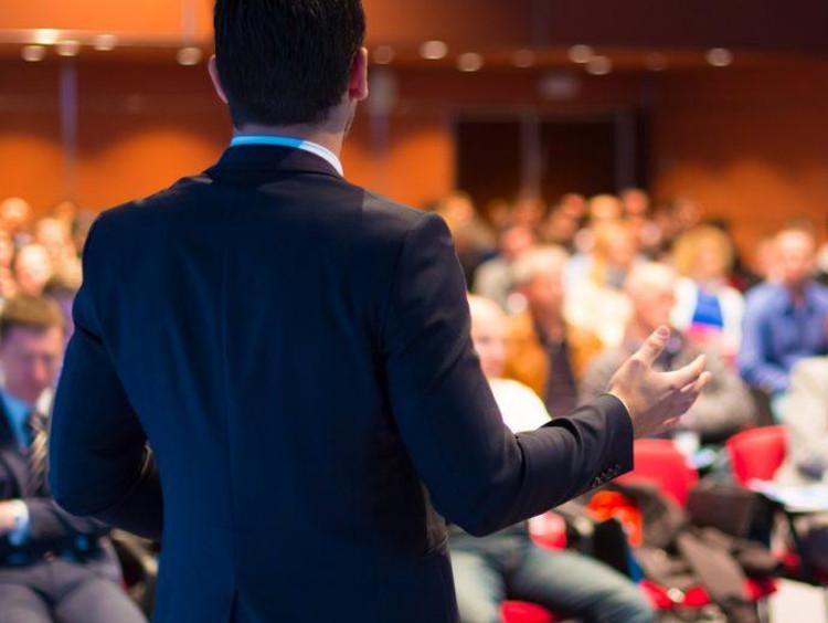 A seminary professor presenting at a convention