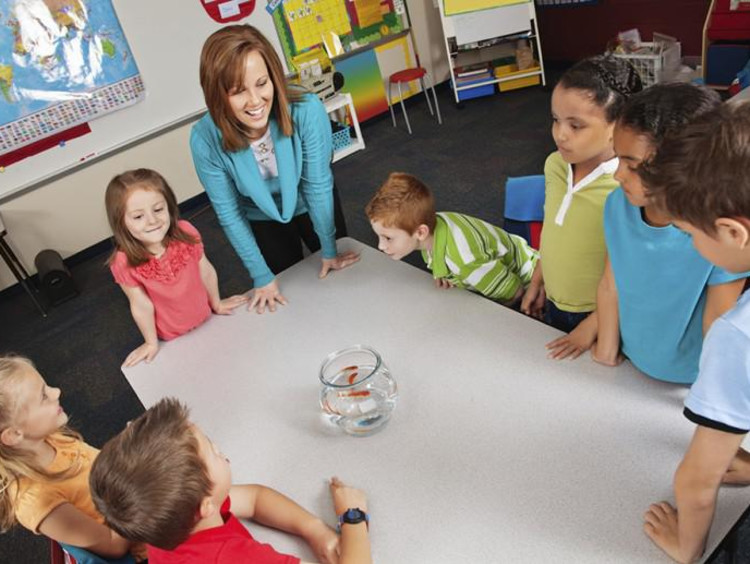 A teacher and students around a table