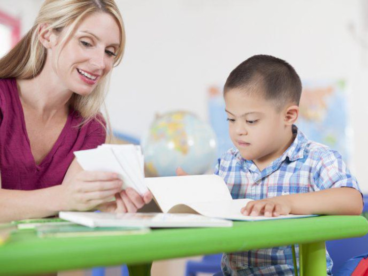 teacher working with a special needs student