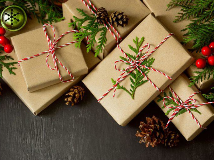 A group of wrapped presents under the tree