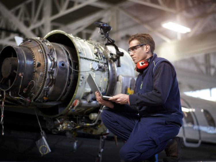 Man working on airplane