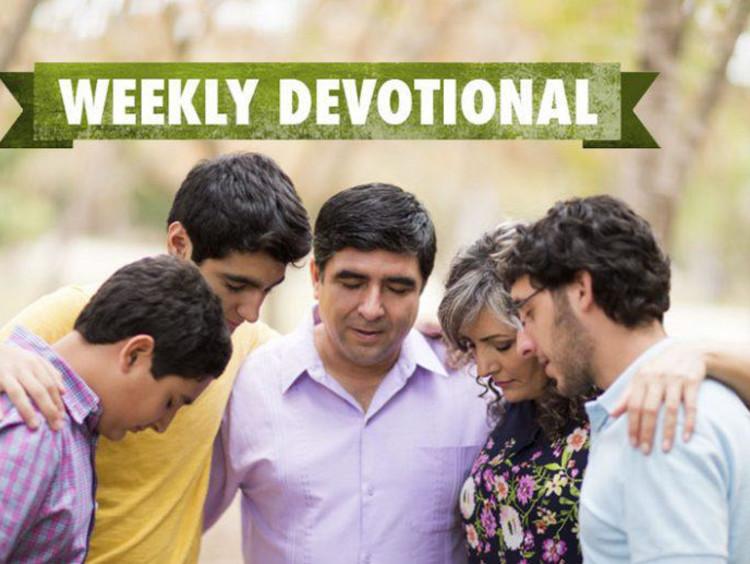 group of people praying.