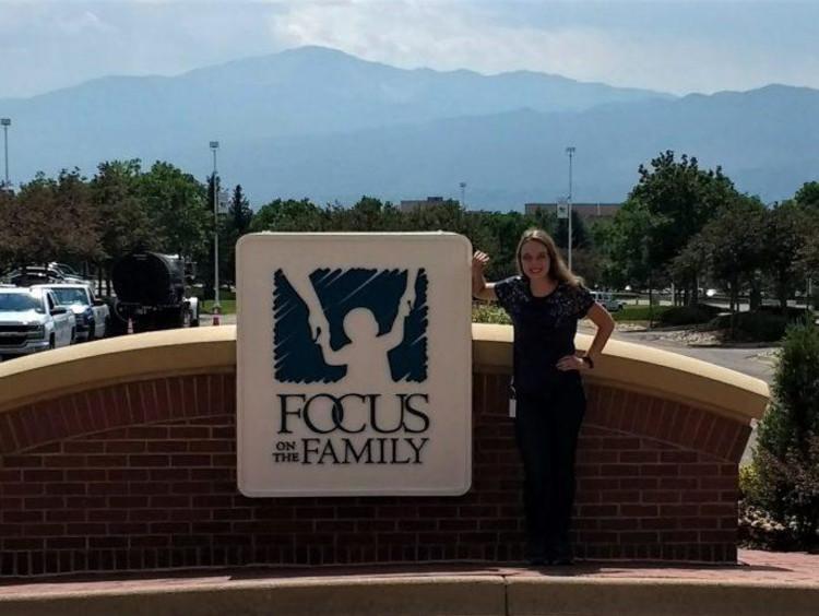 Rachel in front of a FOCUS sign