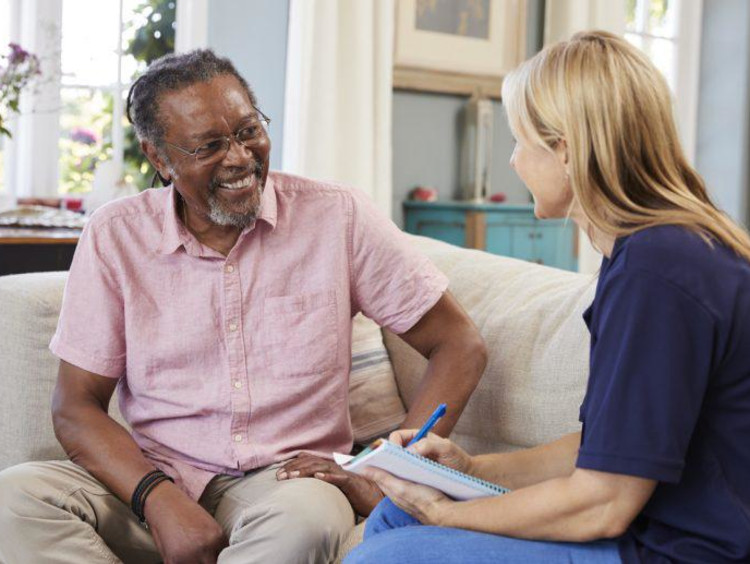 Young psychiatrist with a geropsychology background does assessment on older African-American male