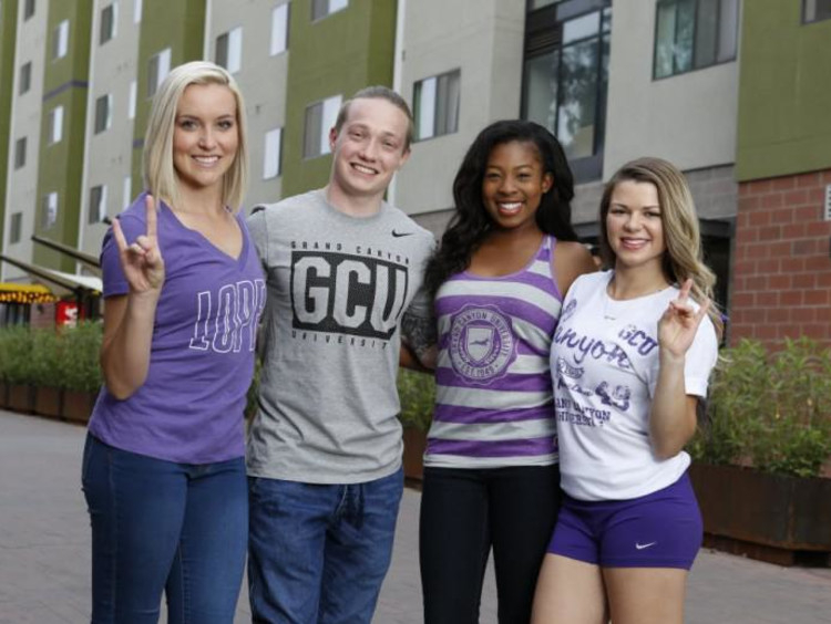 four GCU students smiling