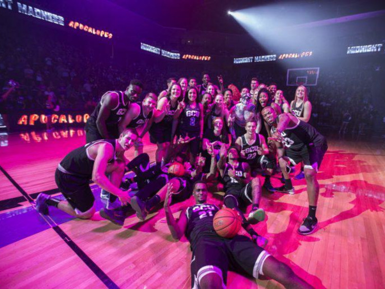 GCU basketball players huddling at a game