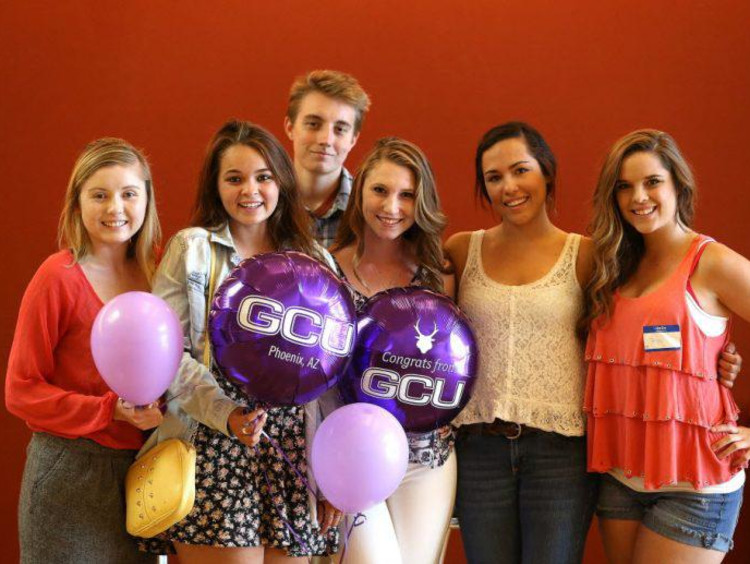 A group of high school students visiting GCU