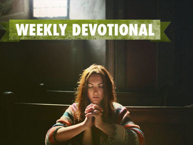 girl praying in dark room