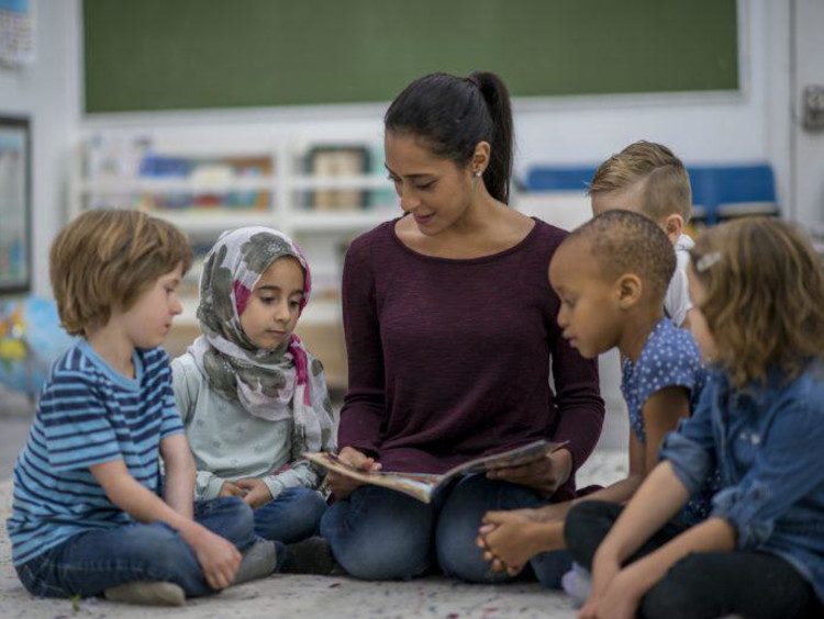 Reading circle time with teacher