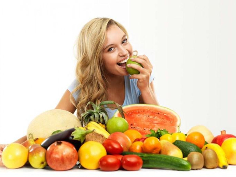 girl eating fruits and vegetables