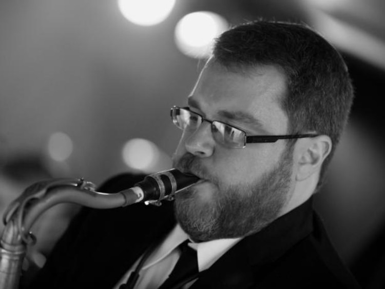 Andrew Gross playing sax