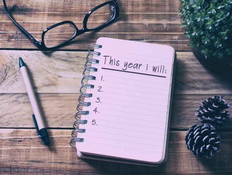A notebook open to a page about new resolutions