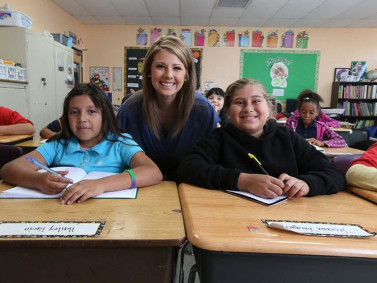 Woman teacher behind two students