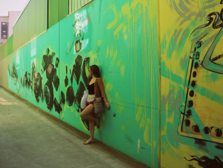 Kate in front of a street art mural