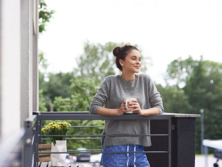 a woman outside with coffee in the morning
