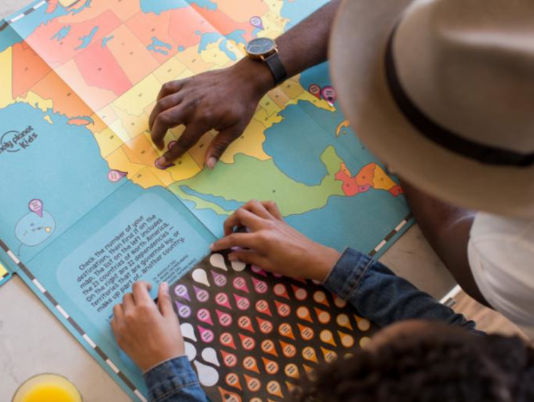 Student and teacher looking at a map