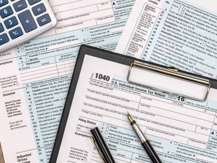 tax forms and paperwork on a table