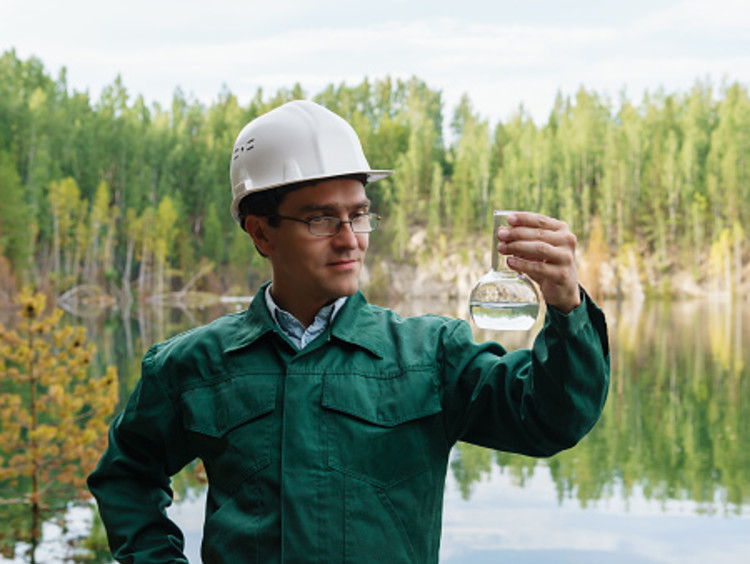 hydrologist collecting water to check environmental health