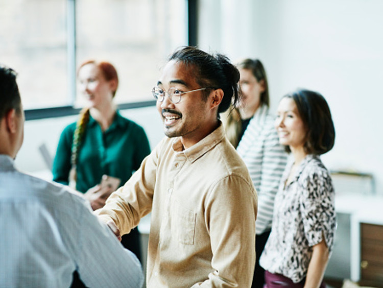students and professionals networking in the workplace