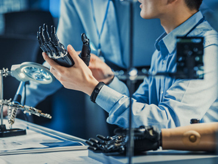 Biomedical engineers with prosthetic arms