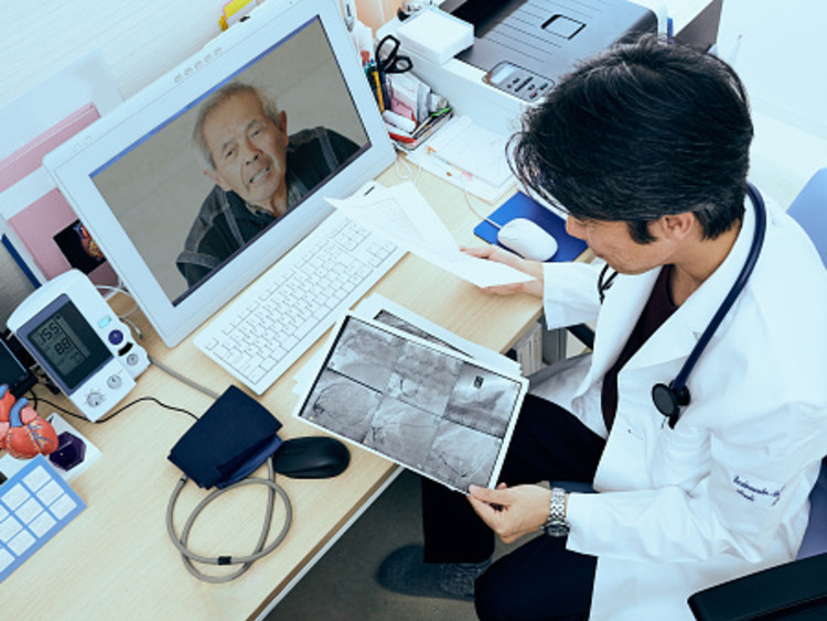 public health professional helping patient during a virtual appointment