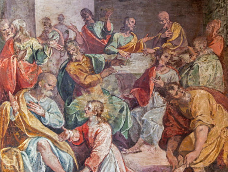 Italian art of Jesus demonstrating to honor one another by washing feet with disciples in background