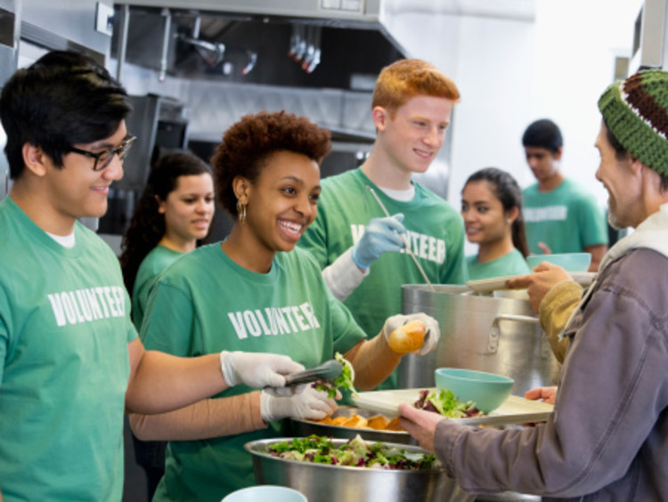 Volunteers in soup kitchen experiencing the gift of work